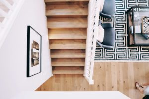 An overhead view of a wooden staircase and wood floors